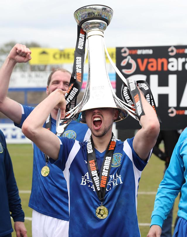 Soccer Football - National League - Macclesfield Town v Dagenham & Redbridge - Moss Rose, Macclesfield, Britain - April 28, 2018 Macclesfield Town's Mitch Hancox celebrates winning the national league as he lifts the trophy Action Images/Peter Cziborra