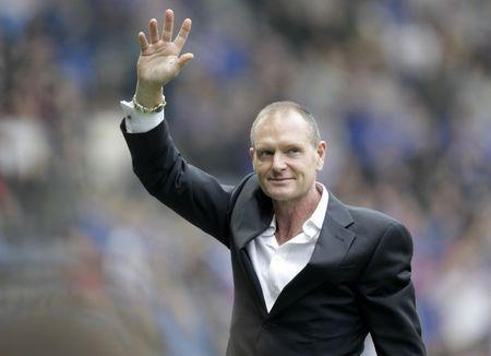 Former Rangers player Paul Gascoigne waves to the crowd at half time Mandatory Credit: Action Images / Graham Stuart