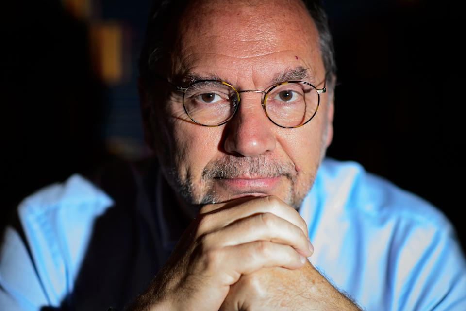 Professor Peter Piot, the Director of the London School of Hygiene and Tropical Medicine, poses for photographs following an interview at his office in central London, England, on July 30, 2014.  Professor Piot was one of the co-discoverers of the Ebola virus during its first outbreak in Zaire, in 1976.  AFP PHOTO/Leon NEAL (Photo by LEON NEAL / AFP) (Photo by LEON NEAL/AFP via Getty Images)