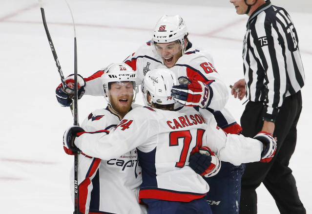 Washington Capitals center Lars Eller, left, celebrates his goal with defenseman John Carlson, center, and left wing Andre Burakovsky, of Austria, during the first period in Game 2 of the NHL hockey Stanley Cup Finals against the Vegas Golden Knights on Wednesday, May 30, 2018, in Las Vegas. (AP Photo/Ross D. Franklin)