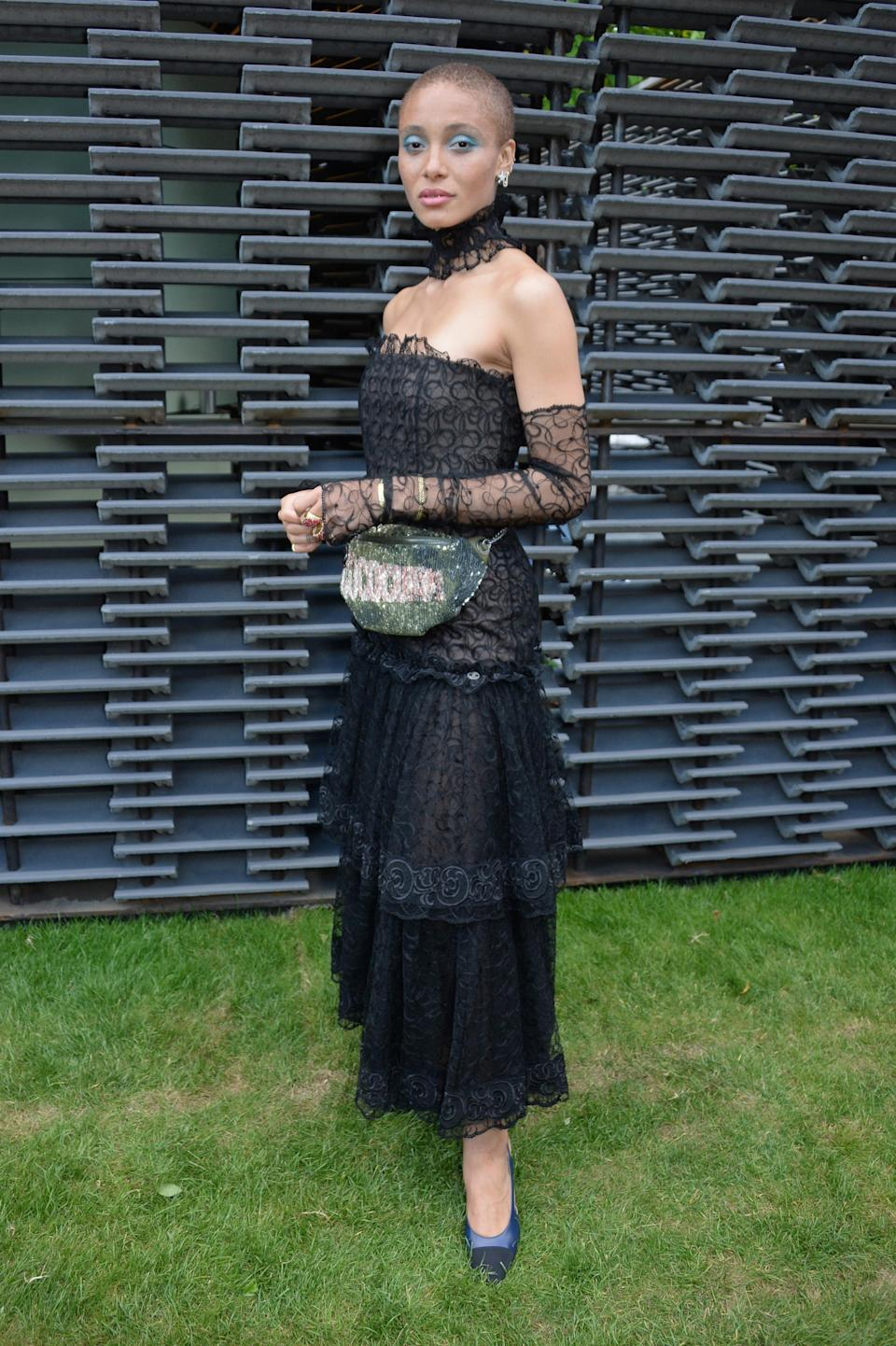 <p>Adwoa Aboah stole the sartorial spotlight at the Serpentine's annual party in an off-the-shoulder lace dress by Chanel. That sequinned belt bag and co-ordinating eyeshadow? We are not worthy. [Photo: Getty] </p>