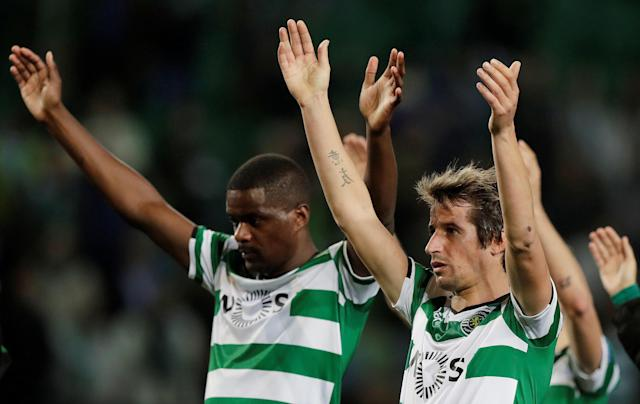 Soccer Football - Europa League Round of 32 Second Leg - Sporting CP vs Astana - Estadio Jose Alvalade, Lisbon, Portugal - February 22, 2018 Sporting's Fabio Coentrao and William Carvalho celebrate after the match REUTERS/Rafael Marchante