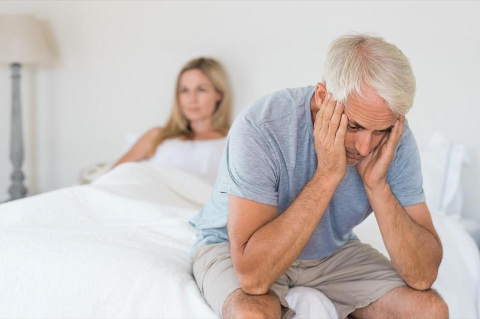 worried senior man in tension at bed.