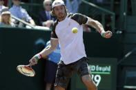 Paolo Lorenzi, of Italy, returns a shot to Nicolas Almagro, of Spain, in their quarterfinal tennis match in the U.S. Men's Clay Court Championship, Friday, April 12, 2013, in Houston. (AP Photo/Pat Sullivan)