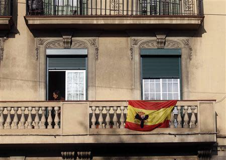 A black ribbon is seen on a Spanish flag at a balcony in Barcelona