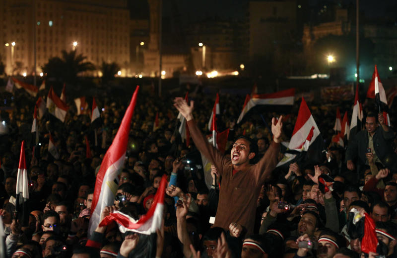 FILE- In this Feb. 11, 2011 file photo, Egyptians celebrate the news of the resignation of President Hosni Mubarak, who handed control of the country to the military, at night in Tahrir Square in downtown Cairo, Egypt. As Egyptians mark the third anniversary of their revolution against autocrat Hosni Mubarak in the name of democracy, there has been a powerful sign of the country's stunning reversals since: letters of despair by some of the prominent activists who helped lead the uprising, leaked from the prisons where they are now jailed. The letters show a daunted and broken spirit, no longer speaking of imminent democracy, but of injustices and a failed struggle. (AP Photo/Ben Curtis)