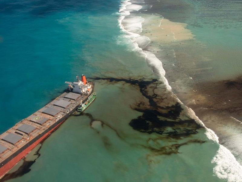 This photo provided by the French Defense Ministry shows oil leaking from the MV Wakashio, a bulk carrier ship that recently ran aground off the southeast coast of Mauritius: AP
