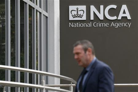 A pedestrian walks past the National Crime Agency (NCA) headquarters in London October 7, 2013. REUTERS/Stefan Wermuth