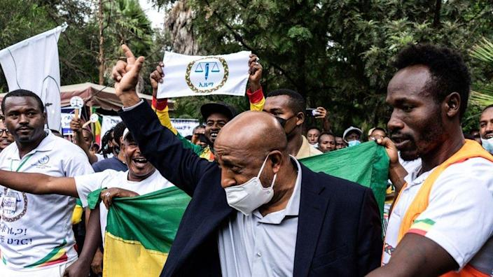 Berhanu Nega, leader of the party Ethiopia Citizens for Social Justice (EZEMA, for its initials in Amharic), greets his supporters while arriving to the closing event of his electoral campaign in Addis Ababa, Ethiopia, on June 13, 2021.