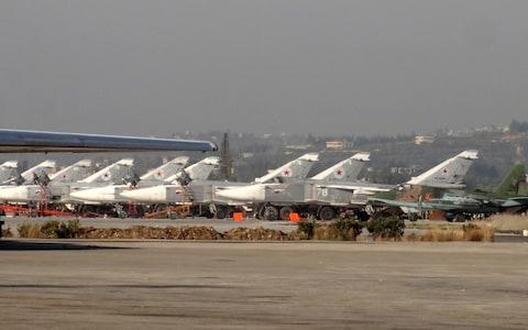 A general view shows Russian fighter jets on the tarmac at the Russian Hmeimim military base in Latakia in 2016 - Credit: AFP/Getty Images