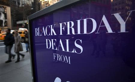 A sign along 5th Ave is pictured during Black Friday Sales in New York