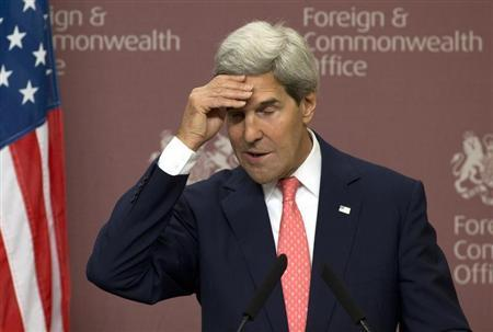 U.S. Secretary of State John Kerry gestures during his news conference with Britain's Foreign Secretary William Hague at the Foreign and Commonwealth Office in London