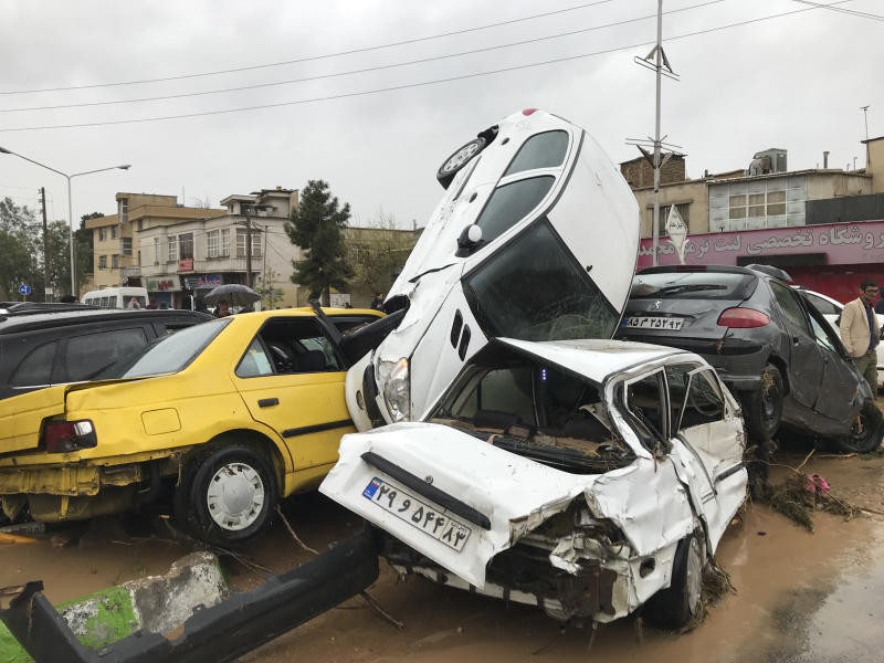 In this photo provided by Mehr News Agency, vehicles are piled up on the street after a flash flood in the southern city of Shiraz, Iran, Monday, March 25, 2019. Iranian state TV reported that flash floods have killed at least 11 people and injured 15 in the country's south. The provinces of Fars, Kurdistan, Qom and Isfahan are also on alert for imminent flooding. (AP Photo/Amin Berenjkar/Mehr News Agency)