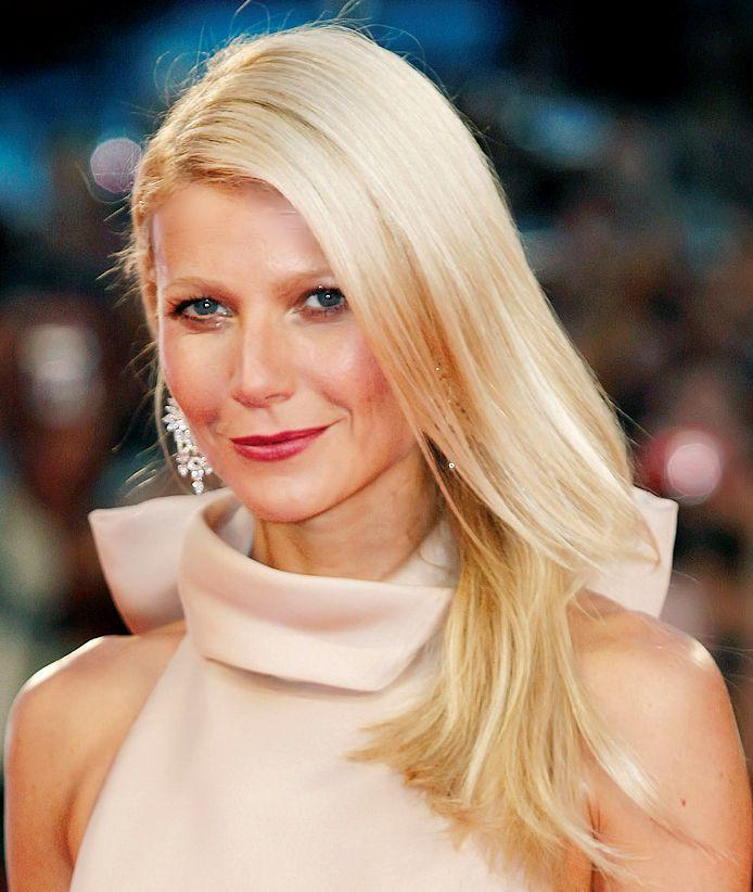 Gwyneth Paltrow looks dazzling in this pink turtle-neck dress, and the smile on her lips is infectious