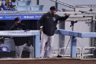 Colorado Rockies manager Bud Black yells at home plate umpire Phil Cuzzi after being ejected from the game during the third inning of a baseball game against the Los Angeles Dodgers Wednesday, April 14, 2021, in Los Angeles. (AP Photo/Mark J. Terrill)
