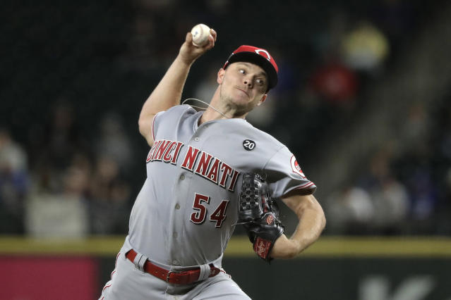 Cincinnati Reds starting pitcher Sonny Gray throws to a Seattle Mariners batter during the fifth inning of a baseball game Wednesday, Sept. 11, 2019, in Seattle. (AP Photo/Ted S. Warren)
