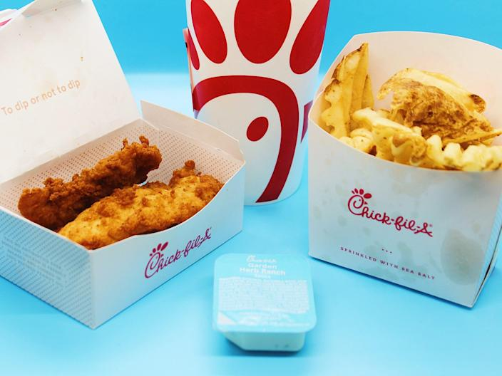 chick fil a chicken tenders fries sauce cup on blue background