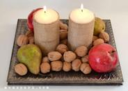 "<p>Make your <a href=""https://momspark.net/simple-thanksgiving-centerpiece/"" rel=""nofollow noopener"" target=""_blank"" data-ylk=""slk:centerpiece"" class=""link rapid-noclick-resp"">centerpiece</a> a little more rustic by wrapping candles in burlap. You can display them alone or add walnuts and seasonal fruit to the platter as well.</p><p><a class=""link rapid-noclick-resp"" href=""https://go.redirectingat.com?id=74968X1596630&url=https%3A%2F%2Fwww.michaels.com%2Fopen-weave-burlap-garland-ashland%2F10336464.html&sref=https%3A%2F%2Fwww.delish.com%2Fholiday-recipes%2Fthanksgiving%2Fg33808794%2Fthanksgiving-decorations%2F"" rel=""nofollow noopener"" target=""_blank"" data-ylk=""slk:BUY NOW"">BUY NOW</a> <em><strong>Burlap garland, $5.49</strong></em><br></p>"
