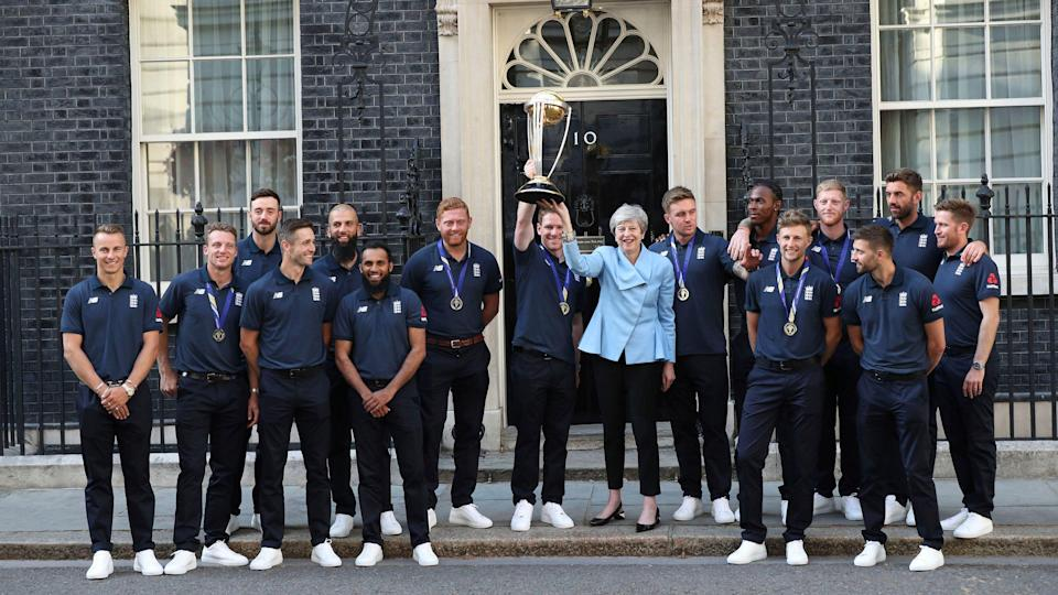 Former Britain's Prime Minister Theresa May with England's 2019 World Cup winning team.