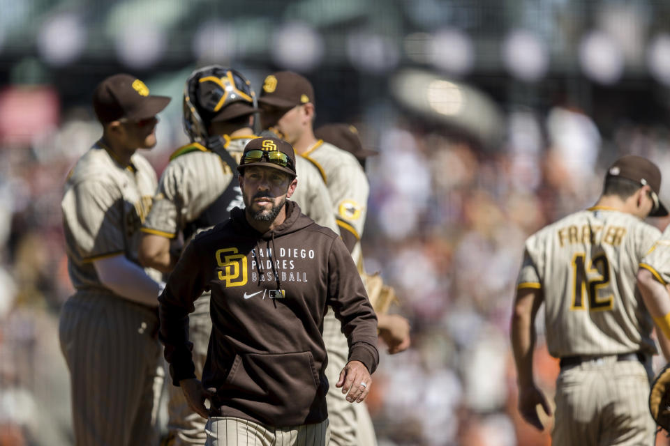 San Diego Padres manager Jayce Tingler walks off the field after replacing pitchers in the fourth inning of a baseball game against the San Francisco Giants in San Francisco, Sunday, Oct. 3, 2021. (AP Photo/John Hefti)