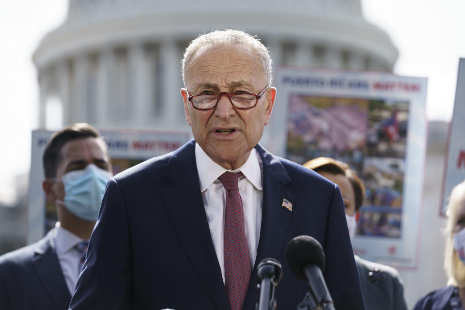 """Senate Majority Leader Chuck Schumer, D-N.Y., joins advocates for Puerto Rico, which still suffers from the effects of Hurricane Maria in 2017, at the Capitol in Washington, Monday, Sept. 20, 2021. Schumer said it was """"extremely disappointing"""" that the Senate's nonpartisan parliamentarian ruled Democrats can't use their $3.5 trillion package bolstering social and climate programs to give millions of immigrants a chance to become citizens. (AP Photo/J. Scott Applewhite)"""