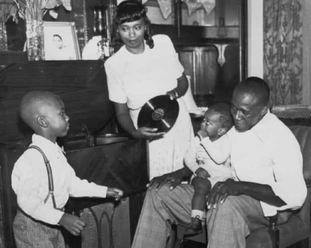 Virnetta Anderson relaxes with her family.