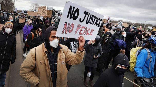 PHOTO: People protesting the shooting death of Daunte Wright by police march to the FBI offices from the Brooklyn Center police station on April 13, 2021, in Brooklyn Center, Minn. (Scott Olson/Getty Images)