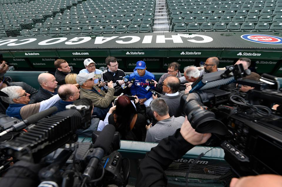 Chicago Cubs shortstop Addison Russell speaks to the media in the dugout before a baseball game against the Miami Marlins. Russell rejoins the team after completing a 40-game suspension for violating Major League Baseball's domestic violence policy and spending extra time in the minors to get ready. (AP)