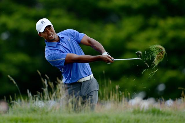 ARDMORE, PA - JUNE 13: Tiger Woods of the United States hits his second shot on the first hole during Round One of the 113th U.S. Open at Merion Golf Club on June 13, 2013 in Ardmore, Pennsylvania. (Photo by David Cannon/Getty Images)
