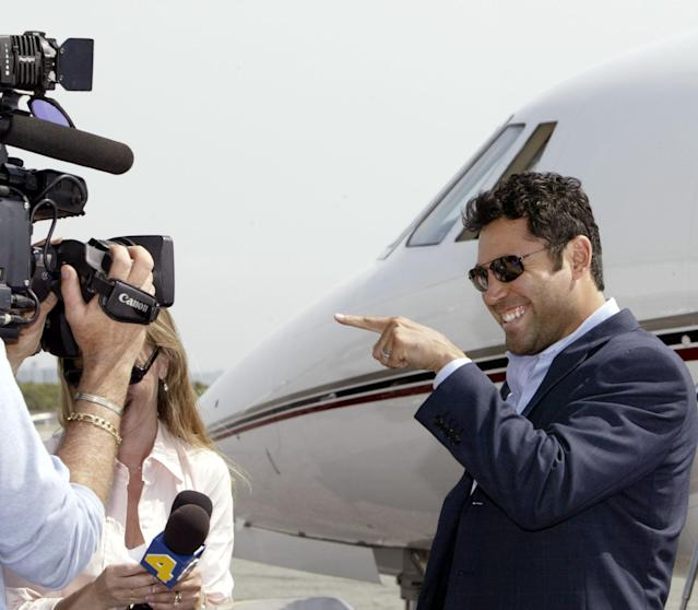 FILE - In this May 17, 2004 file photo, Oscar De La Hoya speaks to the media at the Santa Monica Airport in Santa Monica, Calif., before leaving for Las Vegas. De La Hoya got drunk the night he won the only boxing gold for the U.S. in the 1992 Olympics, and was still drinking when he lost his last fight to Manny Pacquiao. Now sober after a second stint in rehab he's in a fight of another kind for control of his boxing company.(AP Photo/Nick Ut, File)