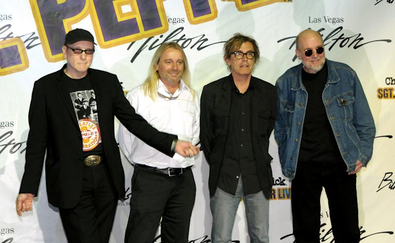Del. judge: Cheap Trick spat belongs in Illinois