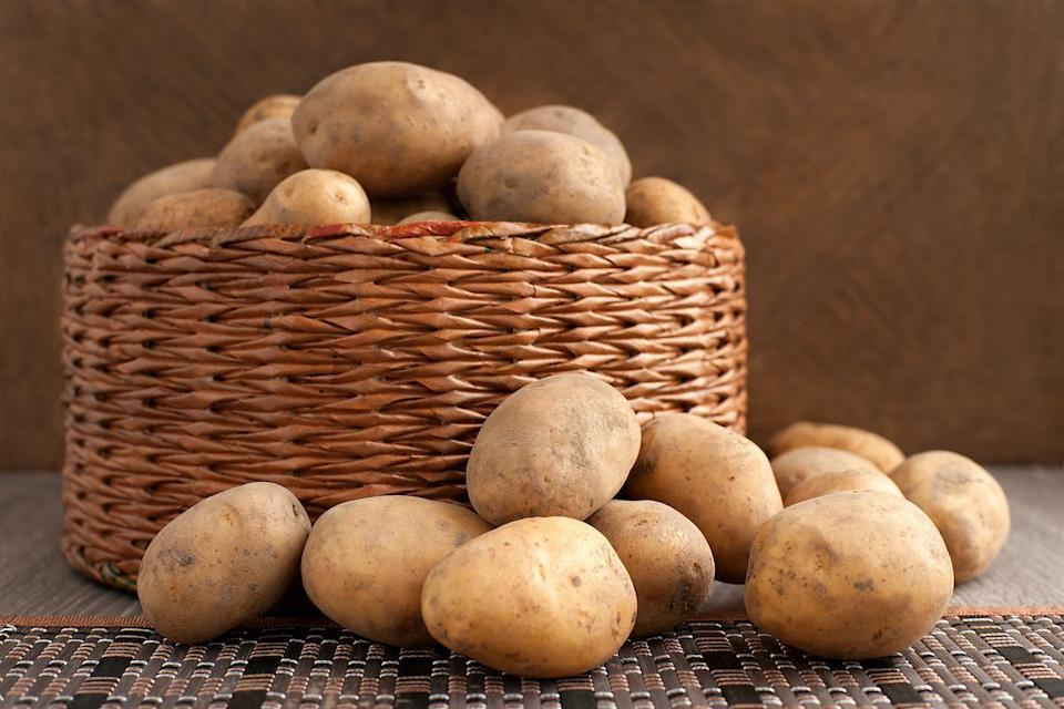 "<p>Raw potatoes have high water content, which makes them explode in the microwave because the steam can't escape through the skin, so pressure builds up and — kaboom. Though there are many other ways to prepare this <a href=""https://www.thedailymeal.com/healthy-eating/foods-gut-health/?referrer=yahoo&category=beauty_food&include_utm=1&utm_medium=referral&utm_source=yahoo&utm_campaign=feed"" rel=""nofollow noopener"" target=""_blank"" data-ylk=""slk:gut-healthy food"" class=""link rapid-noclick-resp"">gut-healthy food</a>, you can poke holes in the sides to avoid detonation if you're dead set on the microwave.</p>"