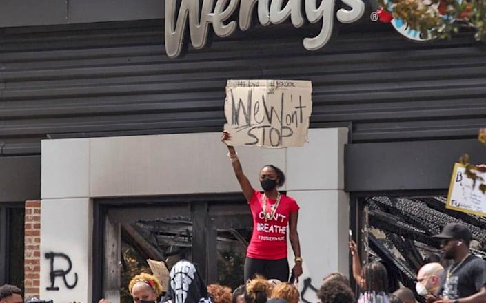 Prostesters last month outside Wendy's restaurant in Atlanta, close to where an 8 year-old was shot dead on July 3, 2020 - Steve Schaefer/Atlanta Journal-Constitution