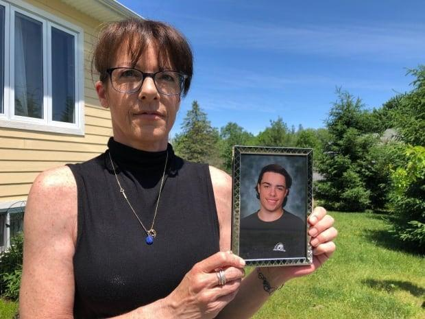 Tracy Wing has been fighting to get more information about the circumstances of the 2018 death of her son, Riley Fairholm. She says Quebec's police watchdog, the Bureau des enquêtes indépendantes, has not been transparent. (Sarah Leavitt/CBC - image credit)