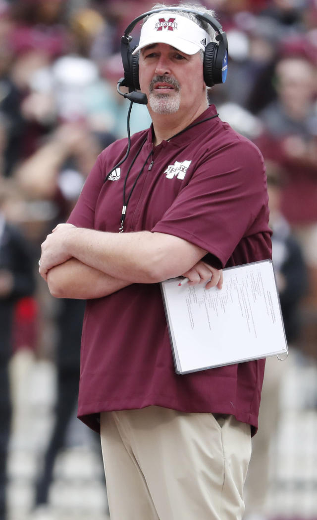 FILE - In this April 13, 2019, file photo, Mississippi State football coach Joe Moorhead observes his team's spring NCAA college football game in Starkville, Miss. Mississippi States lack of a consistent passing offense wrecked what could have been a special season in 2018. Second-year coach Joe Moorhead is working to make sure that never happens again. (AP Photo/Rogelio V. Solis, File)