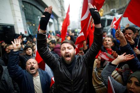 People shout slogans during a protest in front of the Dutch Consulate in Istanbul, Turkey, March 12, 2017. REUTERS/Osman Orsal