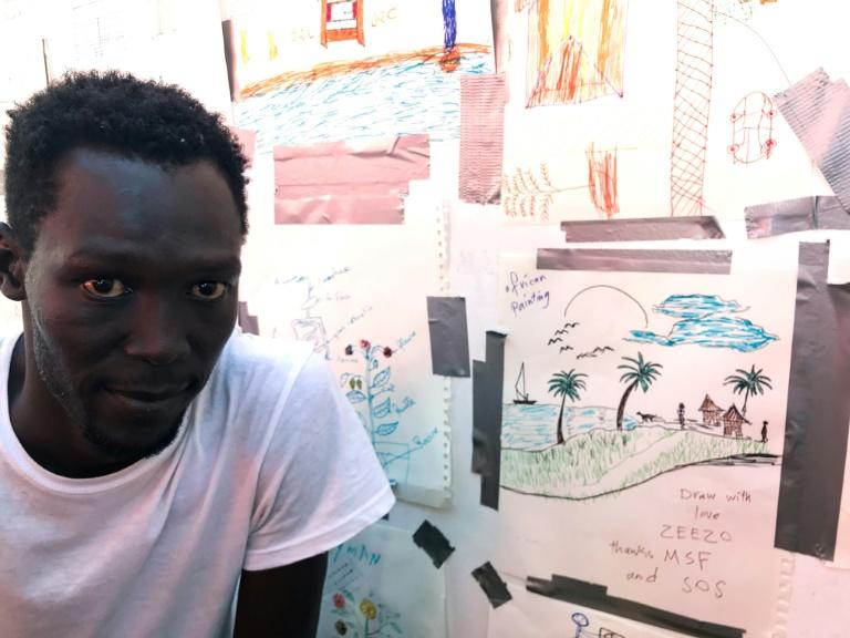 Ezzo's drawing depicts his lakeside village near the Nuna Mountains in southern Sudan (AFP Photo/Anne CHAON)