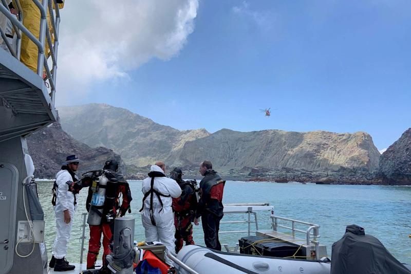 Members of a dive squad conduct a search during a recovery operation around White Island (NEW ZEALAND POLICE via REUTERS)
