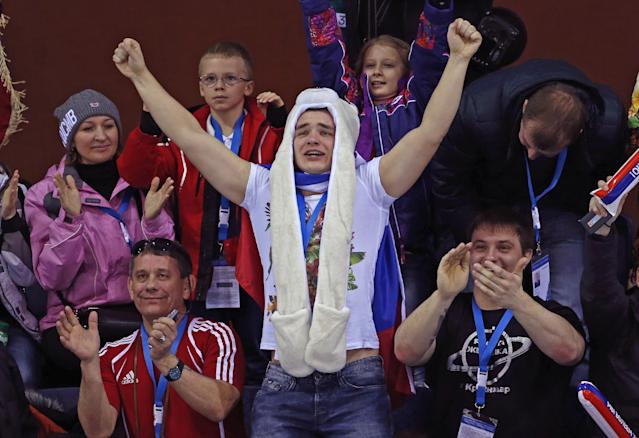 Russian fans cheer during women's curling competition at the 2014 Winter Olympics, Monday, Feb. 10, 2014, in Sochi, Russia. (AP Photo/Robert F. Bukaty)