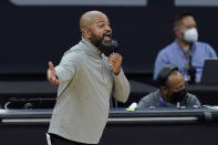 Cleveland Cavaliers coach J. B. Bickerstaff gestures to players during the first half of the team's NBA basketball game against the Sacramento Kings in Sacramento, Calif., Saturday, March 27, 2021. (AP Photo/Jeff Chiu)
