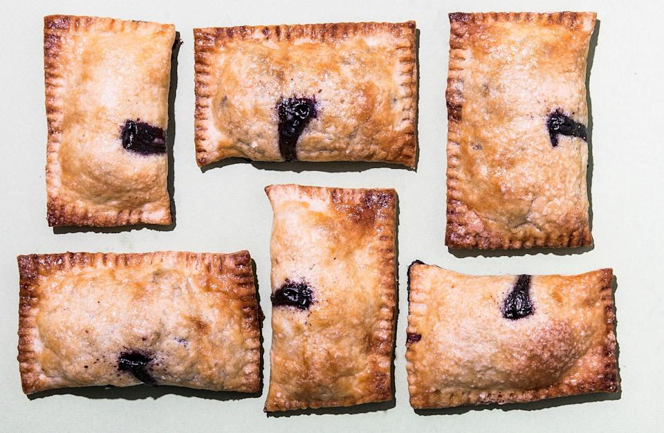 """It may not seem like very much filling, but these handheld pastries deliver the perfect filling-to-crust ratio (and if you overstuff the dough, they'll be impossible to seal). <a href=""""https://www.bonappetit.com/recipe/blueberry-lemon-hand-pies?mbid=synd_yahoo_rss"""" rel=""""nofollow noopener"""" target=""""_blank"""" data-ylk=""""slk:See recipe."""" class=""""link rapid-noclick-resp"""">See recipe.</a>"""