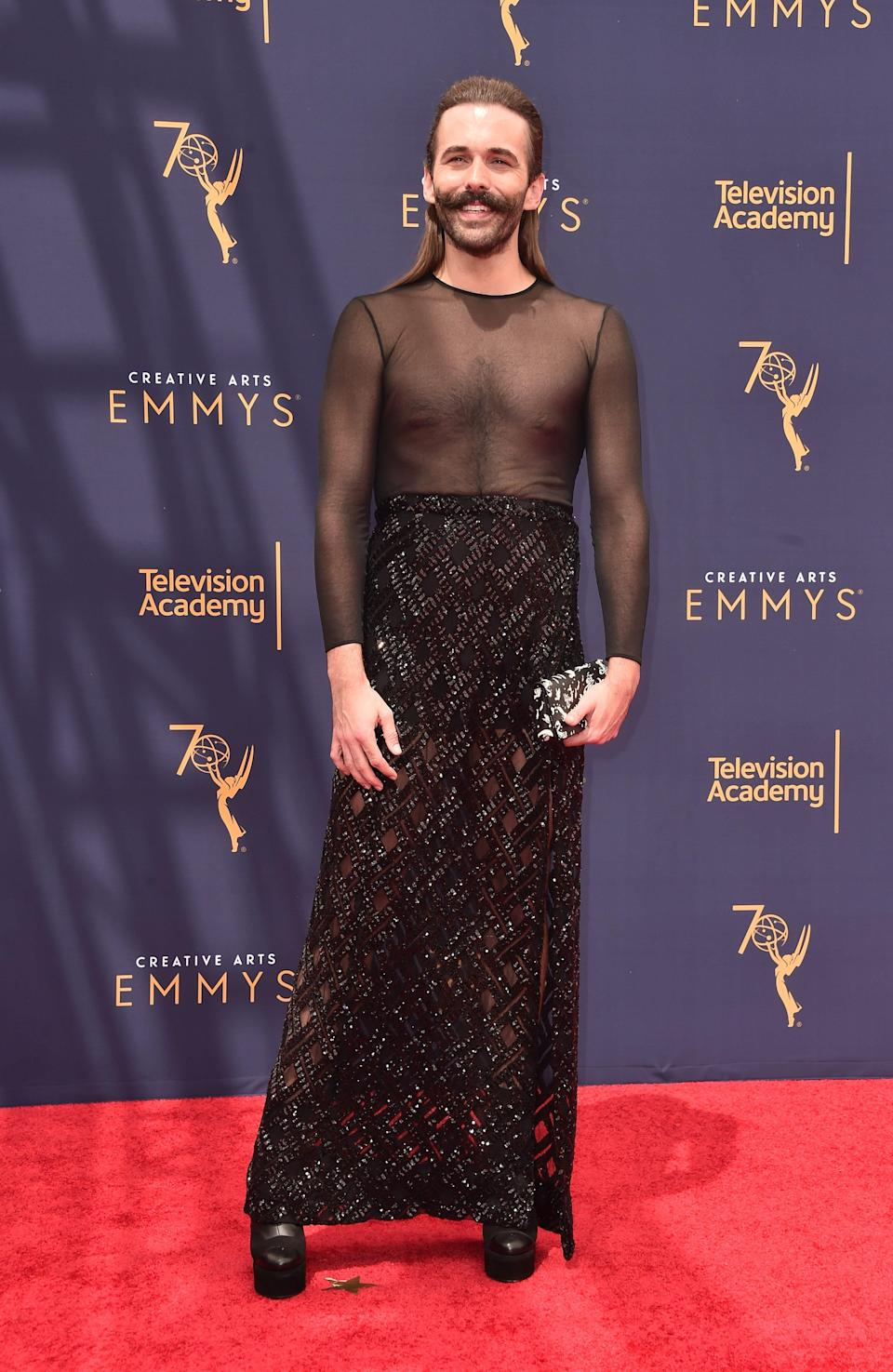 Jonathan Van Ness wears a dress with a sheer top at the Emmys in 2018.