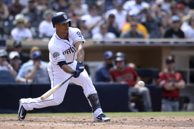 San Diego Padres' Francisco Mejia hits an RBI double during the fifth inning of a baseball game against the Arizona Diamondbacks Wednesday, April 3, 2019, in San Diego. (AP Photo/Orlando Ramirez)