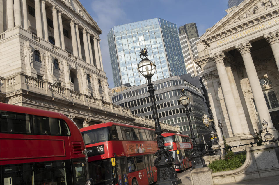 Days before the Chancellor Rishi Sunak delivers his Budget, buses queue at red lights with a wide view of the Bank of England (left) and Royal Exchange (right) in the City of London, the capital's financial district, on 1st March 2021, in London, England. (Photo by Richard Baker / In Pictures via Getty Images)