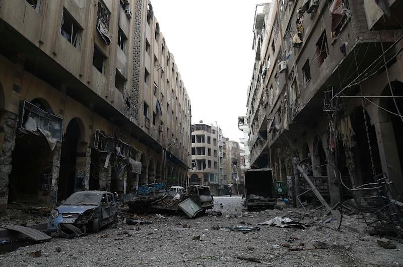 Syria's complex war has killed more than 270,000 people and displaced half the population (AFP Photo/Sameer Al-Doumy)