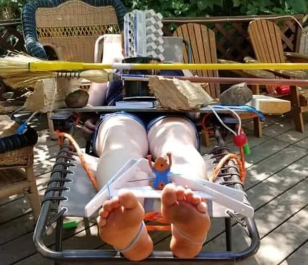Michelle Grodecki sent this picture with the caption, 'That one time I thought it would be okay to relax since the kids were all busy playing.' (Submitted by Michelle Grodecki - image credit)