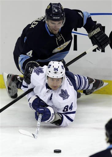 Pittsburgh Penguins' Zbynek Michalek (4) collides with Toronto Maple Leafs' Mikhail Grabovski (84) in the first period of an NHL hockey game in Pittsburgh on Wednesday, March 7, 2012. (AP Photo/Gene J. Puskar)