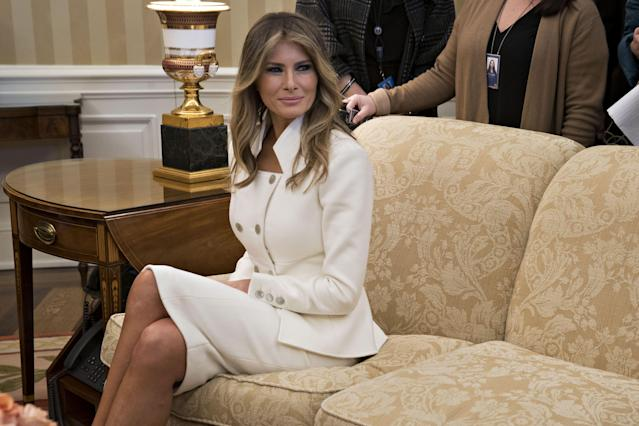 <p>In her first official appearance at the White House since Trump's inauguration, Melania is seen here in a custom-made white skirt suit by Karl Lagerfeld.</p>