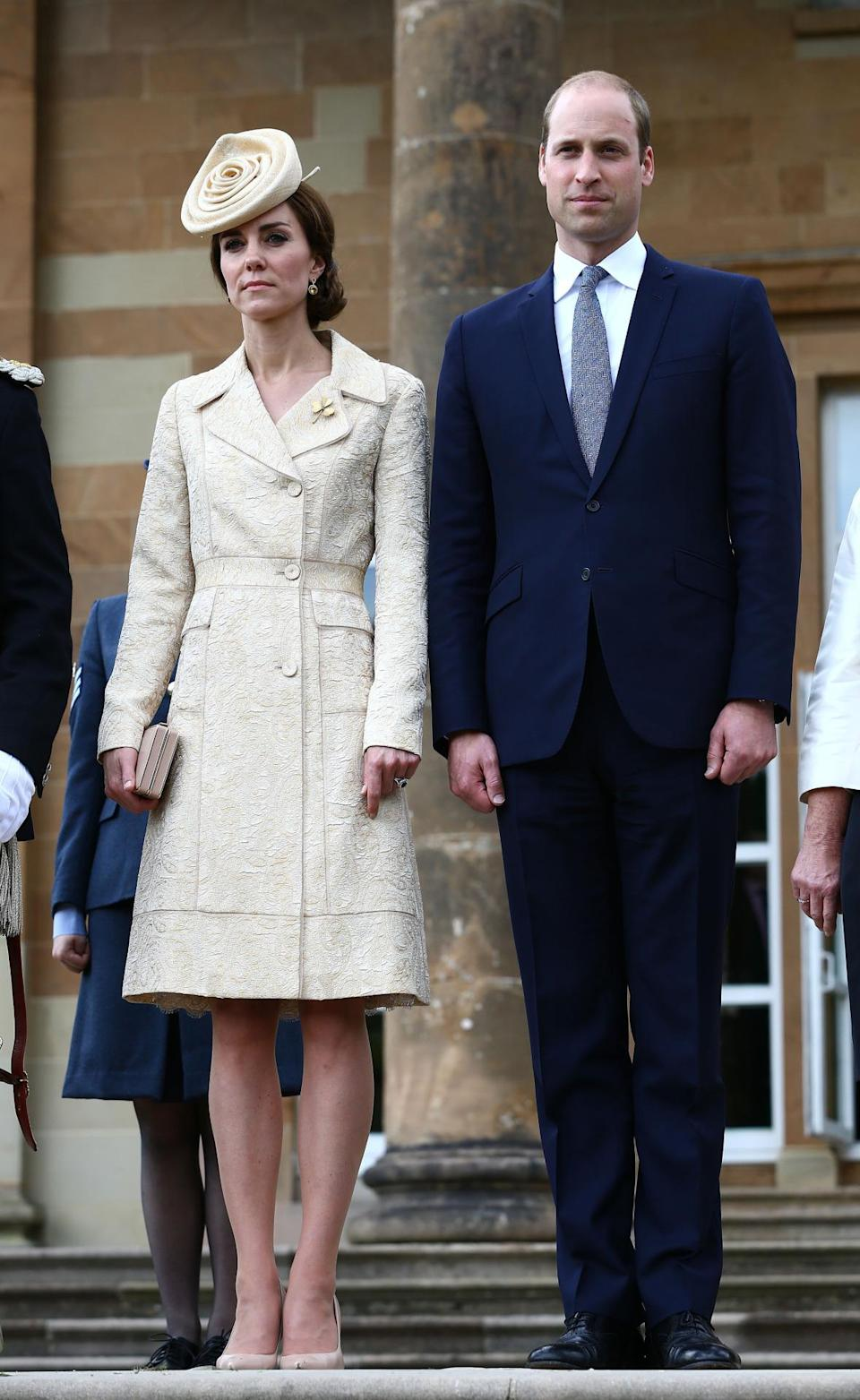 <p>Danish label Day Birger et Mikkelsen were the designers behind Kate's champagne brocade coat. A Lock & Co hat inspired by the morning rose flower topped off her outfit to a garden party hosted by Northern Ireland's Secretary of State.</p><p><i>[Photo: PA]</i></p>