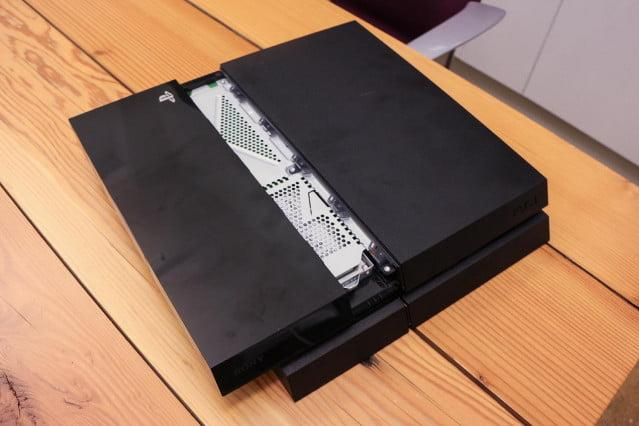 Step 1. Place the PlayStation 4 on a secure surface, and press down on the glossy, black side of the top panel. With the system's front facing you, slide the panel leftward. It should slide right off; no screws needed.